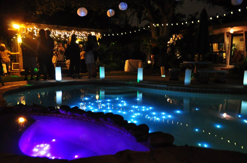 string lights around the pool pool landscaping ideas