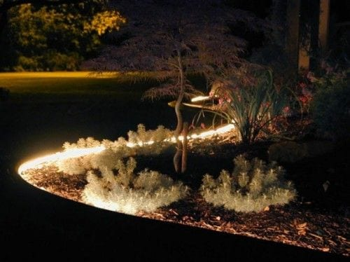 rope lighting around flower beds pool landscaping ideas